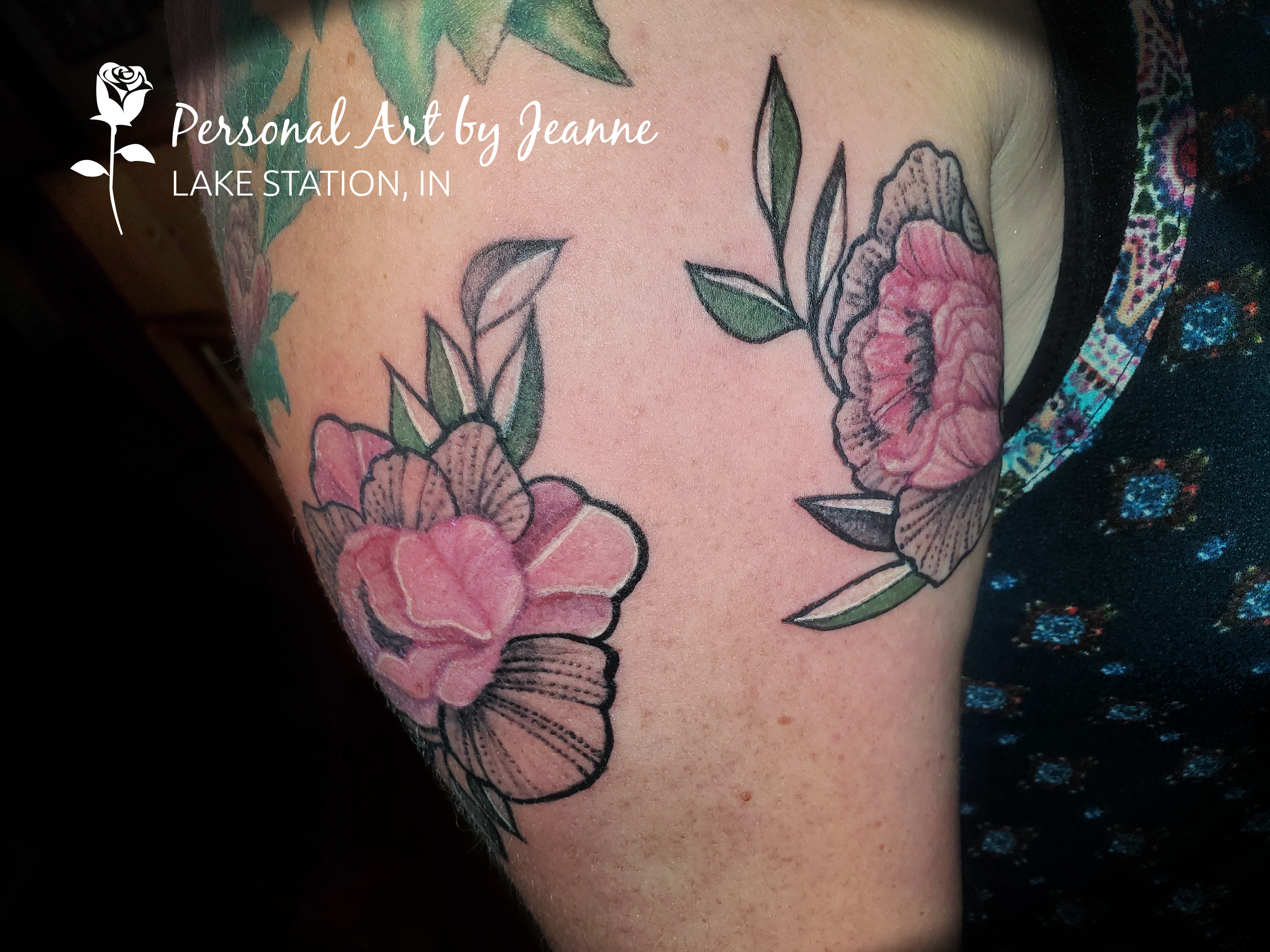 peony tattoos on an arm done by Jeanne at Personal Art