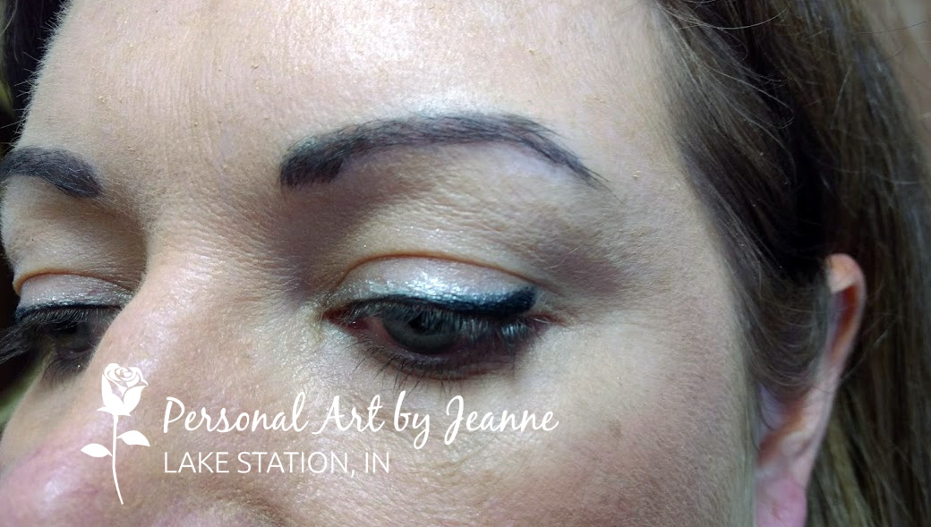 Permanent eyeliner with uptail and highlight by Jeanne at Personal Art, Inc.